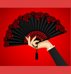 female hand with open black vintage fan isolated vector image