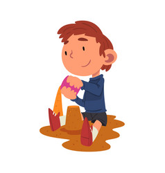 Cute boy playing in sandpit on playground vector