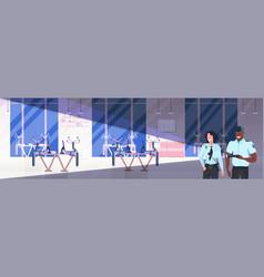 Mix race security guards using flashlight man vector
