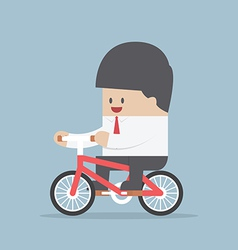 Businessman riding a bicycle to work vector image