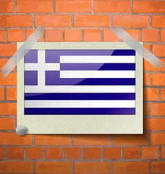 Flags Greece scotch taped to a red brick wall vector