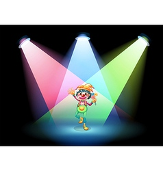 A female clown with flowers at the stage vector image