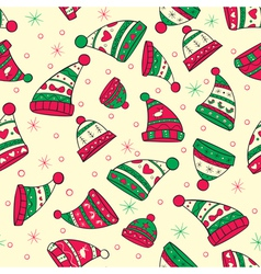 Winter seamless pattern with red green hats vector