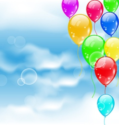 Flying colourful balloons in blue sky vector image