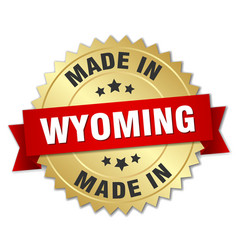 Made in wyoming gold badge with red ribbon vector