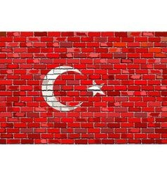 Grunge flag of Turkey on a brick wall vector image