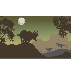 Silhouette of triceratops and baby T-Rex vector