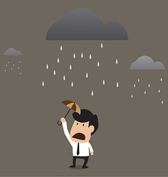 Businessman under a little umbrella in the rain vector image vector image