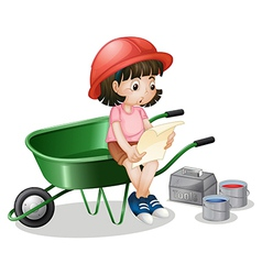 A girl reading while sitting in a green cart vector image