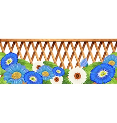 A fence with blue and white flowers vector