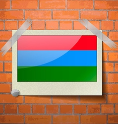 Flags Karelia scotch taped to a red brick wall vector