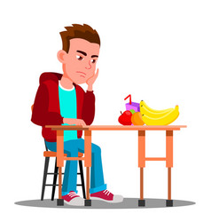 Sad child at table with food refuses to eat vector