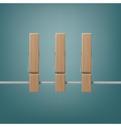 Wooden clothespins pegs on rope side view close up vector
