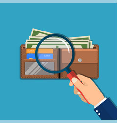 hand with magnifying glass vector image