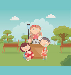 Kids with cardboard box full toys in park vector