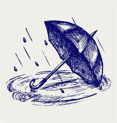 Rain drops rippling in puddle and umbrella vector