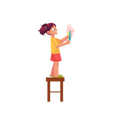 Little girl washing a plate standing on stool vector