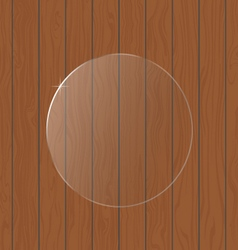 Round glass on a wooden background vector