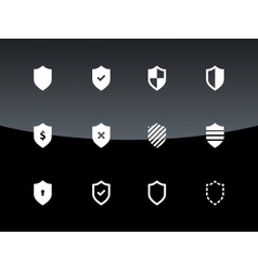 Shield icons on black background vector image