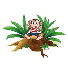A monkey sitting above the chopped wood vector image