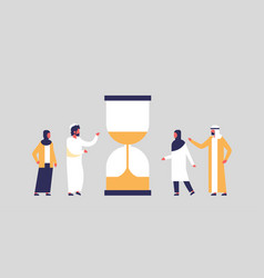 arabian people group standing hourglass time vector image