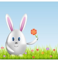 Easter bunny and colorful eggs on spring medow vector image