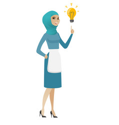 Young muslim cleaner pointing at idea bulb vector