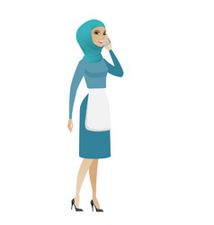 young muslim cleaner talking on a mobile phone vector image vector image