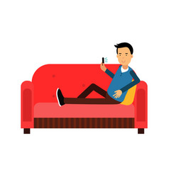 young man sitting on a sofa using his smartphone vector image