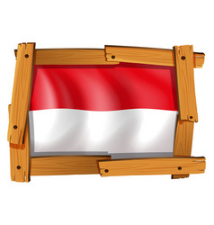 Indonesia flag in wooden frame vector