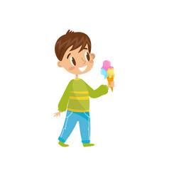 cute boy eating ice cream cone vector image
