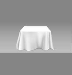 Realistic white tablecloth on square table vector