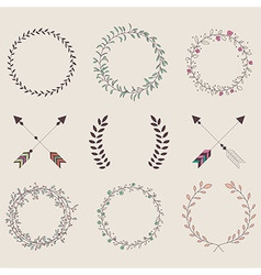 Hand drawn vintage arrows feathers dividers vector image