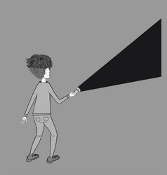 a young man holding a flashlight shines in the dar vector image
