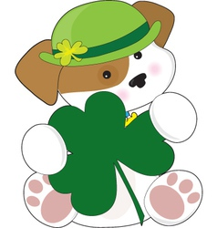 a cute puppy is wearing a green irish hat and is h vector image vector image