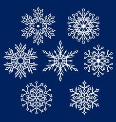 White silhouettes of snowflake vector