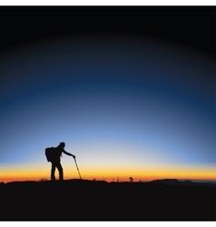 Hiking man and sunrise vector image