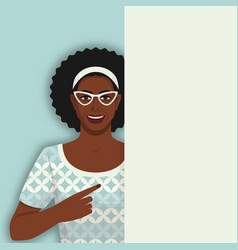 smiling retro black woman points at blank poster vector image