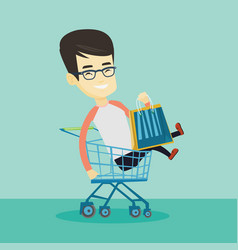 happy man riding by shopping trolley vector image