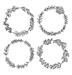 Set black hand-drawn wreaths on white vector
