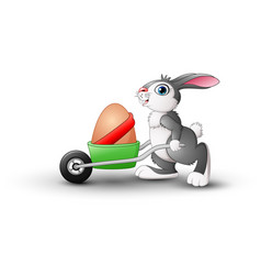 Easter bunny pushing a cart of easter eggs vector