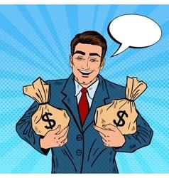 Smiling Businessman Holding Money Bags Pop Art vector image vector image