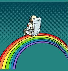 Astronaut sits on a rainbow vector