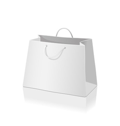 Empty paper shopping bag isolated on white vector