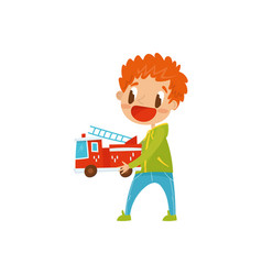 redhead little boy playing wirh fire truck cute vector image