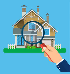 Magnifying glass with house vector
