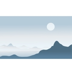 Silhouette of mountain with fog vector
