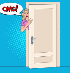 Pop art shocked woman peeking from behind a door vector