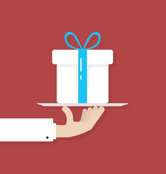 Hand holding big white gift box on plate vector