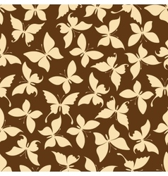 Seamless yellow silhouettes of butterflies pattern vector